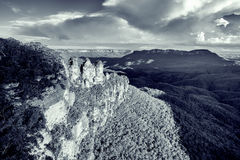 Famous Three Sisters rock formation in Blue Mountains of NSW, Au. Stralia. Toned black and white image Royalty Free Stock Images