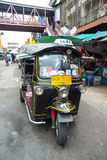 Famous three-wheeled taxi (tuktuk) parking at the street Royalty Free Stock Photo