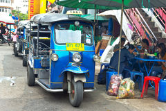 Famous three-wheeled taxi (tuktuk) parking at the street Stock Images
