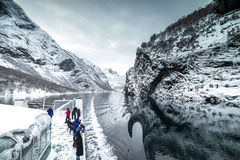 Famous throughout the world Norwegian fjords. NORWAY BERGEN - DECEMBER, 28: tourist ferry passes through the famous throughout the world Norwegian fjords, on Stock Image