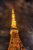Famous Tokyo tower glowing in bright lights in Tokyo, Japan. Famous Tokyo tower , a communications and observation tower in the Shiba-koen district of Minato royalty free stock image