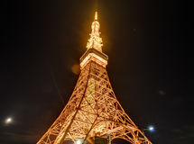 Famous Tokyo tower glowing in bright lights in Tokyo, Japan. Famous Tokyo tower , a communications and observation tower in the Shiba-koen district of Minato royalty free stock photography