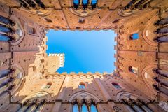 Famous Torre del Mangia in Siena, Italy Royalty Free Stock Photography