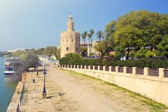 The famous Torre del Oro, the Moorish tower built to defend Sevi. The famous Golden tower, Torre del Oro, along the Guadalquivir river, the Moorish tower built Stock Image