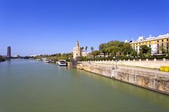 The famous Torre del Oro, the Moorish tower built to defend Sevi. The famous Golden tower, Torre del Oro, along the Guadalquivir river, the Moorish tower built Royalty Free Stock Photo