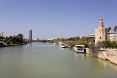 The famous Torre del Oro, the Moorish tower built to defend Sevi. The famous Golden tower, Torre del Oro, along the Guadalquivir river, the Moorish tower built Royalty Free Stock Photography