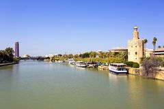 The famous Torre del Oro, the Moorish tower built to defend Sevi. The famous Golden tower, Torre del Oro, along the Guadalquivir river, the Moorish tower built Stock Photography
