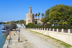 The famous Torre del Oro, the Moorish tower built to defend Sevi. The famous Golden tower, Torre del Oro, along the Guadalquivir river, the Moorish tower built Royalty Free Stock Photos