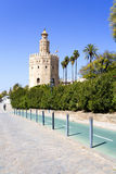 The famous Torre del Oro, the Moorish tower built to defend Sevill. The famous Golden tower, Torre del Oro, along the Guadalquivir river, the Moorish tower built royalty free stock photos