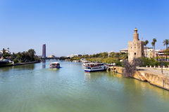 The famous Torre del Oro, the Moorish tower built to defend Sevi Royalty Free Stock Photo