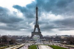 Tour Eiffel at the end of winter under storm clouds royalty free stock image