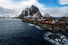 Famous tourist attraction Hamnoy fishing village on Lofoten Islands, Norway with red rorbu houses in winter. royalty free stock photography