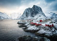 Famous tourist attraction Hamnoy fishing village on Lofoten Islands, Norway with red rorbu houses in winter. royalty free stock images