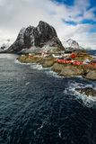 Famous tourist attraction Hamnoy fishing village on Lofoten Islands, Norway with red rorbu houses in winter. stock photos