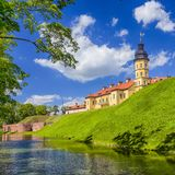 Famous Tourist Destinations.Backside of  Renowned Nesvizh Castle. Famous Tourist Destinations.Backe of  Renowned Nesvizh Castle on The Moat as a Profound Example Royalty Free Stock Photos