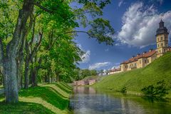 Famous Tourist Destinations.Backside of  Renowned Nesvizh Castle. Famous Tourist Destinations.Backe of  Renowned Nesvizh Castle on The Moat as a Profound Example Royalty Free Stock Image