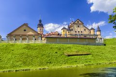 Famous Tourist Destinations.Backside of  Renowned Nesvizh Castle. Famous Tourist Destinations.Backe of  Renowned Nesvizh Castle on The Moat as a Profound Example Stock Image