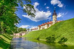 Famous Tourist Destinations.Backside of  Renowned Nesvizh Castle. Famous Tourist Destinations.Backe of  Renowned Nesvizh Castle on The Moat as a Profound Example Royalty Free Stock Photo