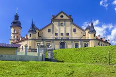 Famous Tourist Destinations. Renowned Nesvizh Castle on The Hill. As a Profound Example of Medieval Ages Heritage and Reence of the Radziwill Family.Horizontal Royalty Free Stock Photo