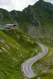 Transfagarasan mountain road with small building on rock, Romanian Carpathians Stock Image