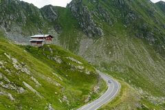 Transfagarasan mountain road with small building on rock, Romanian Carpathians Royalty Free Stock Photography