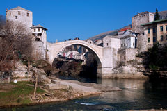 Old Bridge in the city with ancient buildings stock image