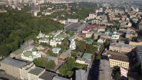 Aerial view to Ascension Convent woman monastery Sts. Florus and Laurus at Podil region, Kyiv, U. Famous touristic places in Kyiv - Aerial view to Ascension stock footage