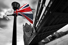 Famous Tower Bridge, London, UK. Famous Tower Bridge with flag of England in London, UK Stock Photography