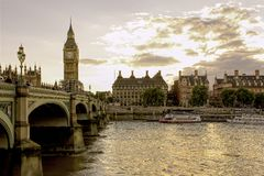 Famous tower clock Big Ben in London,Uk, during sunset over rive stock images