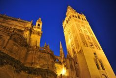 Giralda tower at night, Cathedral of Seville, Andalusia, Spain. Famous tower of Giralda, Islamic architecture built by the Almohads and crowned by a Renaissance royalty free stock image