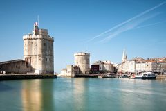 The famous towers of La Rochelle, a town in western France, are. Located at the entrance to the old port. La Rochelle is the capital of the Charente-Maritime stock photo