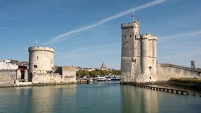 The famous towers of La Rochelle, a town in western France, are. Located at the entrance to the old port. La Rochelle is the capital of the Charente-Maritime royalty free stock images