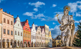 Famous town square of Telc, Czech Republic. Main square of Telc with its famous 16th-century colorful houses, a UNESCO World Heritage Site since 1992, on a sunny Royalty Free Stock Photos