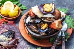 Famous traditional dish of the south of Chile and the Chiloe archipelago - Curanto al Hoyo, Kuranto. Different seafood stock images
