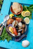 Famous traditional dish of the south of Chile and the Chiloe archipelago - Curanto al Hoyo, Kuranto. Different seafood stock photo