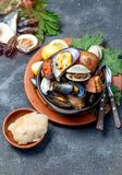 Famous traditional dish of the south of Chile and the Chiloe archipelago - Curanto al Hoyo, Kuranto. Different seafood royalty free stock images