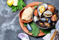 Famous traditional dish of the south of Chile and the Chiloe archipelago - Curanto al Hoyo, Kuranto. Different seafood royalty free stock image