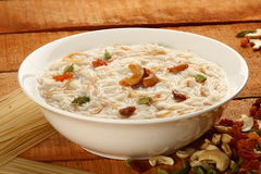 Famous and traditional Indian sweet pudding Kheer in a white bowl Stock Image