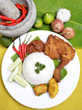 Famous traditional Malay Food. An image of the famous traditional Malay Food Delicious 'Ayam Penyet' with 'Sambal Belacan' and 'Tempe'- local flavor stock photography