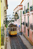 Famous tram line 28 passing a narrow street in Alfama district i Royalty Free Stock Photo