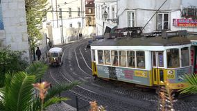 An old tram on the street in Lisbon stock footage