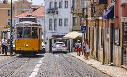 Famous tram in the streets of Lisbon old town called Electrico - LISBON - PORTUGAL - JUNE 17, 2017. Famous tram in the streets of Lisbon old town called stock image