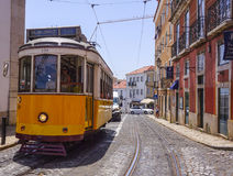 Famous tram in the streets of Lisbon old town called Electrico - LISBON - PORTUGAL - JUNE 17, 2017. Famous tram in the streets of Lisbon old town called royalty free stock photography