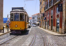 Famous tram in the streets of Lisbon old town called Electrico - LISBON - PORTUGAL - JUNE 17, 2017. Famous tram in the streets of Lisbon old town called royalty free stock photos