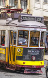 Famous tram in the streets of Lisbon old town called Electrico - LISBON - PORTUGAL - JUNE 17, 2017. Famous tram in the streets of Lisbon old town called royalty free stock image