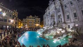 The famous Trevi Fountain at night timelapse. This place is one of the most visited in Rome. Crowd stay agound. Fisheye stock video footage