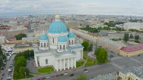 The famous Trinity Cathedral with blue domes and gilded stars, view of the historic part of the city of Staint-Petersburg, typical. Houses around stock footage