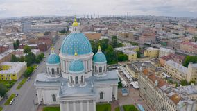 The famous Trinity Cathedral with blue domes and gilded stars, view of the historic part of the city of Staint-Petersburg, typical. Houses around stock video footage