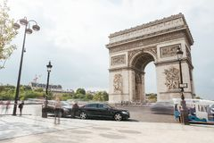 Famous Triumphal Arch, symbol of the glory and historical heritage. Iconic architectural landmark of Paris, France. Charles de Gaulle square. City traffic Stock Images