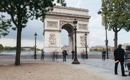 Famous Triumphal Arch, symbol of the glory and historical heritage. Iconic architectural landmark of Paris, France. Charles de Gaulle square. City traffic Stock Photography